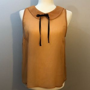 Burnt orange tie neck blouse